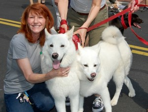 Kim and white dogs